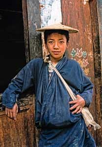 Bhutanese boy wearing a bamboo hat