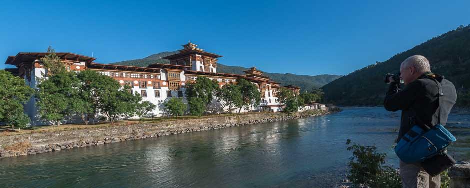 A man is photographing Punakha Dzong, Bhutan
