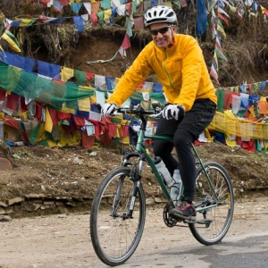 Jock Montgomery cycling in Bhutan on one of his private expeditions