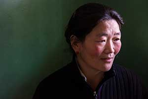 Portrait of a Tibetan woman from Lhasa taken by Jock Montgomery during a photography tour.