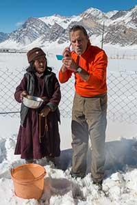 Jock Montgomery shaving with the help of a Ladakhi friend