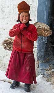 Novice Ladakhi Monk carrying firewood, Indian Himalaya