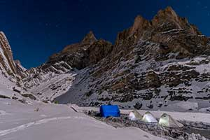 A winter campsite by moonlight in the Ladakh Himalaya