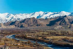 Headwaters of the Indus and Thiksey Monastery in the distance, the Ladakh valley of the Indian Himalaya