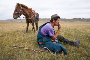 A muslim Mongolian nomad with his horse