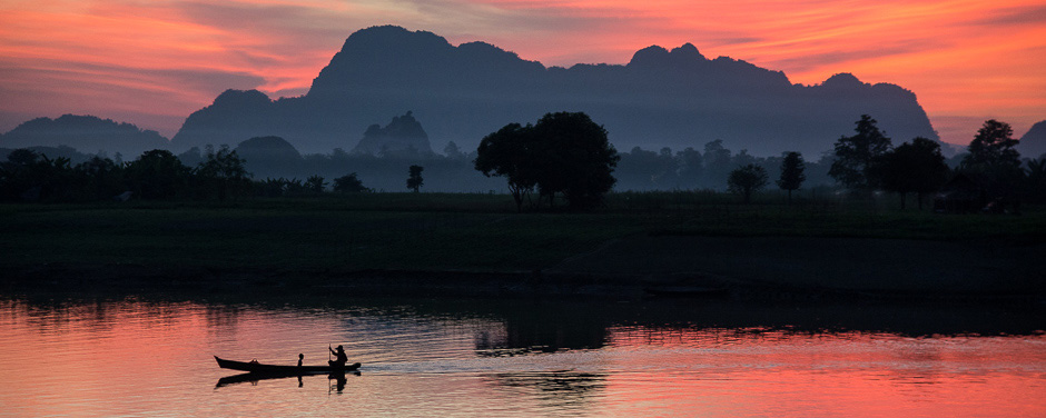 Paddling canoe at sunset on the Salween River, Hpa-An, Myanmar