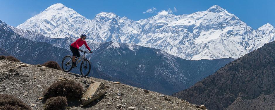 Mountain Biking Mustang Nepal, with the Annapurna mountain range behind