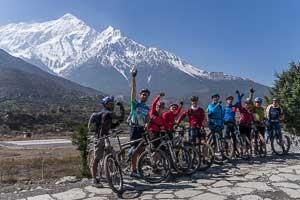 Our 2014 mtn biking group near near Jomsom Nepal, with Nigiri Peak behind