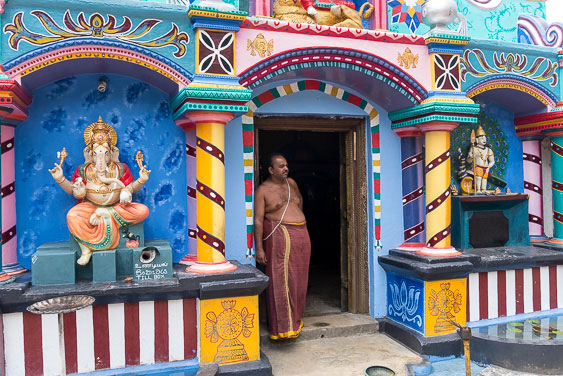 A Hindu temple and care taker in Sri Lanka
