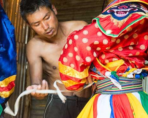 Bhutan, Buddhist Cham dancers getting dressed
