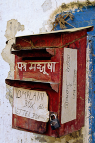 """Nepal """"Complaint box"""" for letters and complaints posted to white-washed wall."""