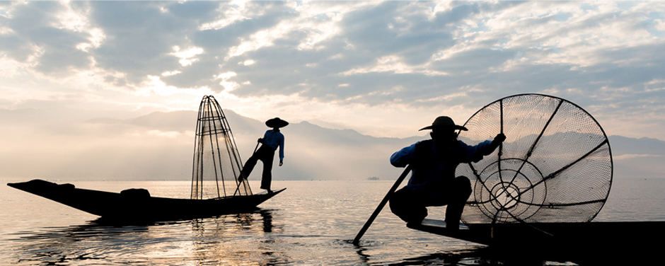 Fisherman on Inle Lake captured early morning on a photography tour by Jock Montgomery.